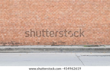 Closeup surface of brick pattern at old brown brick wall with street floor textured background