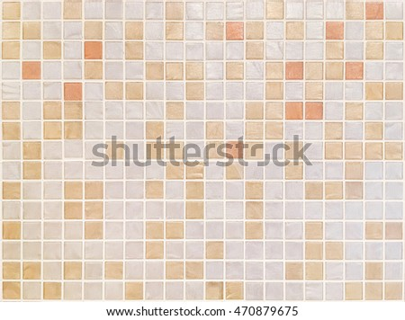 Closeup surface tiles pattern at brown brown tiles in bathroom wall texture background