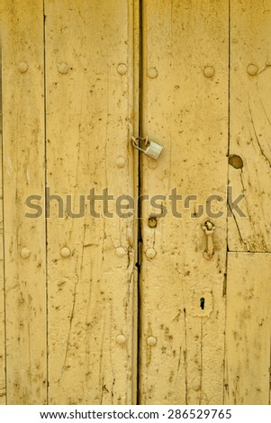 Closeup take of the wooden planks of an old door