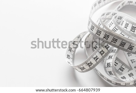 closeup tape measuring on white background