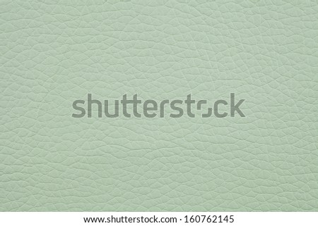 Closeup texture of light green leather for background - stock photo