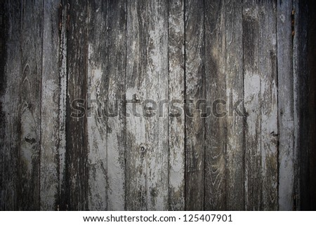 Closeup texture of rustic gray wooden fence - stock photo