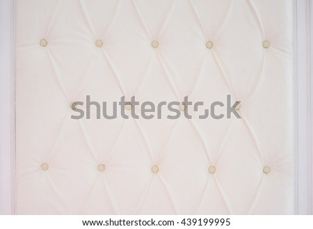 Closeup texture of vintage beige leather sofa for background - stock photo