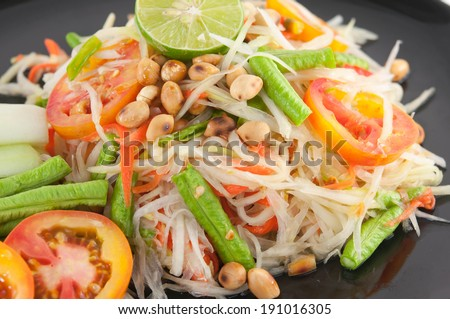 Closeup Thai papaya salad serve with vegetables - stock photo