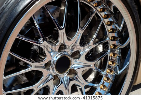 Closeup the chromeplated rim of a wheel - stock photo