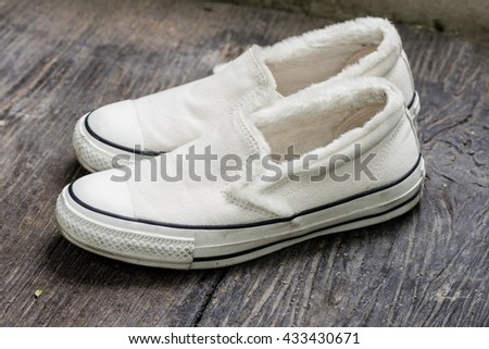 closeup the white women sneakers without laces - stock photo