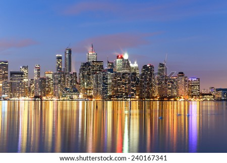 Closeup to buildings in downtown Toronto at twilight