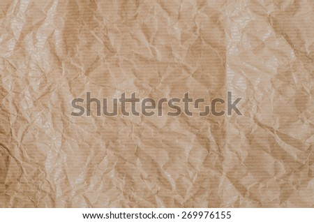 closeup to creased brown paper texture background - stock photo