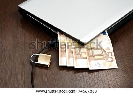 Closeup to laptop and euro banknotes - stock photo