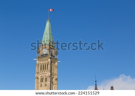 Closeup to the Ottawa Parliament Clock Tower with copy space - stock photo