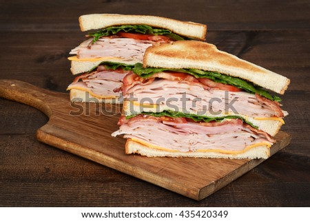 closeup toasted chicken club sandwich - stock photo