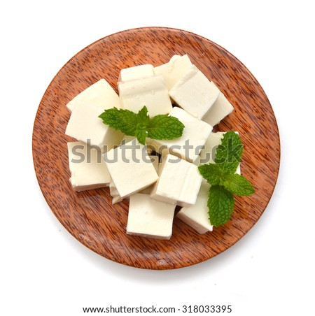closeup tofu isolated in wooden bowl on white background  - stock photo