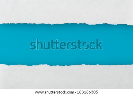 Closeup Torn Paper with blue blank space for your text - stock photo