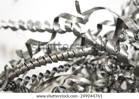Closeup twisted spiral steel shavings. Drilling, lathe and milling industry. Metal engineering technology. - stock photo
