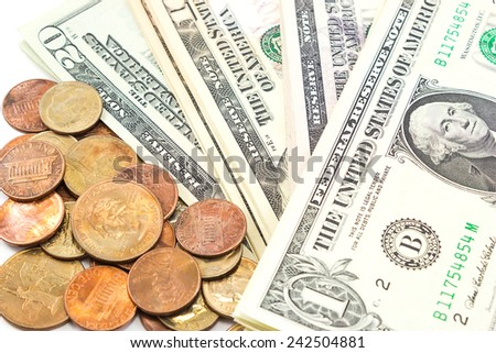Closeup US dollar bills and coins on white background. - stock photo
