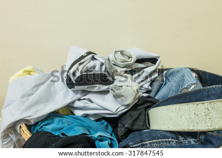 Closeup used clothes in wood basket - stock photo