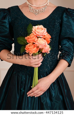 closeup Victorian woman holding roses