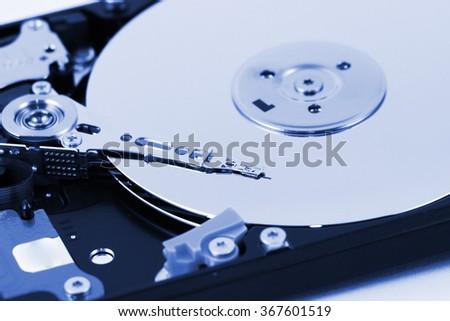 Closeup view of a computer hard disc - stock photo