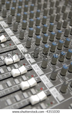 closeup view of a DJ's mixing desk with shallow depth of field - stock photo
