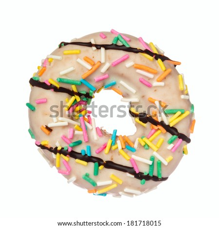 Closeup view of a donut with sprinkles isolated on white - stock photo