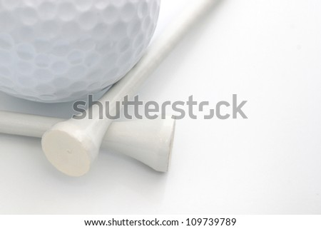 Closeup view of a golf ball with white tees over white - stock photo