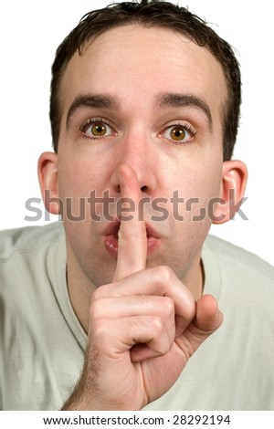Closeup view of a man holding his finger to his lips expressing that he wants quiet, isolated against a white background - stock photo