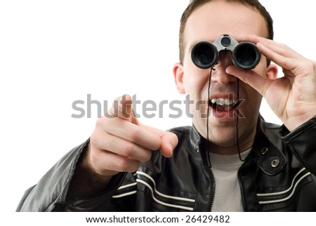 Closeup view of a man watching through a set of binoculars and pointing, isolated against a white background - stock photo