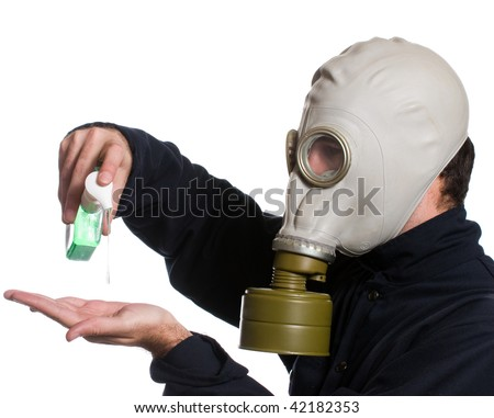 Closeup view of a man wearing a gas mask using some hand sanitizer to kill any germs, isolated against a white background