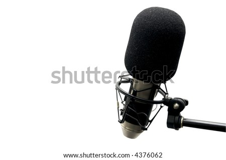 closeup view of a microphone isolated on a white background and including a clipping path - stock photo