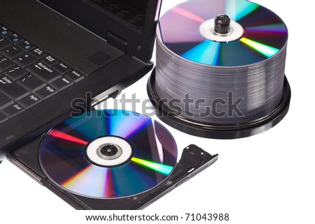 Closeup view of a modern high-end laptop computer with its CD/DVD optical drive open - stock photo