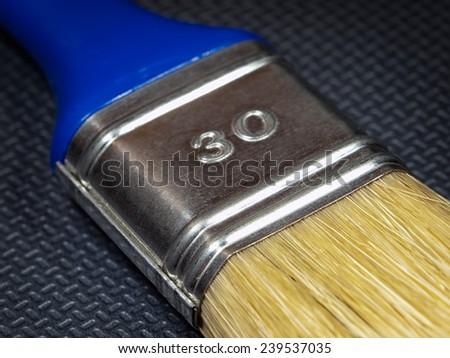 Closeup view of a paintbrush. - stock photo