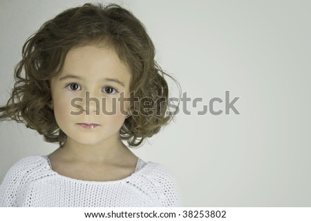 closeup view of a sweet little girl, a bit sad