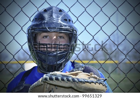 closeup view of a young baseball catcher - stock photo