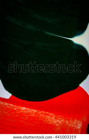 Closeup view of abstract hand painted black and red acrylic art background on paper texture - stock photo