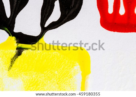 Closeup view of abstract hand painted black yellow and red acrylic art background on paper texture