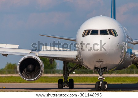 Closeup view of an aircraft preparing to take off. - stock photo