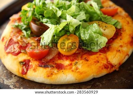 closeup view of bacon, lettuce and tomato pizza - stock photo