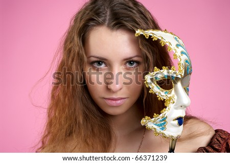 Closeup view of beautiful woman in evening dress with carnival mask - stock photo