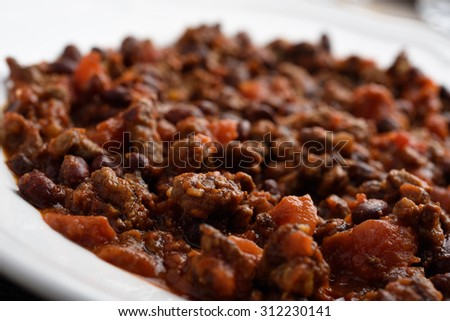Closeup view of chili con carne in a bowl. Selective focus - stock photo