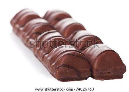 Closeup view of chocolate bars over white background - stock photo