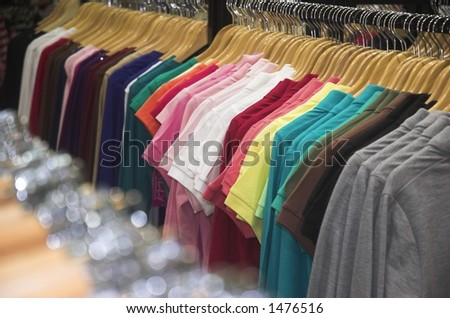 closeup view of clothes in a ladies clothing store - stock photo