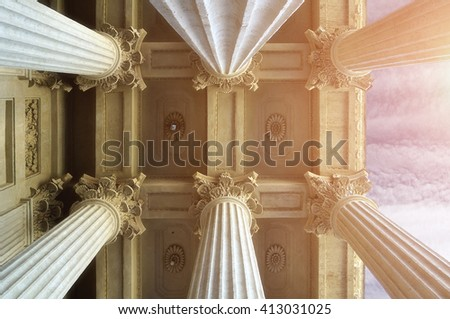 Closeup view of colonnade tops and the ceiling of famous Kazan Cathedral under soft sunlight  in Saint-Petersburg, Russia.  - stock photo