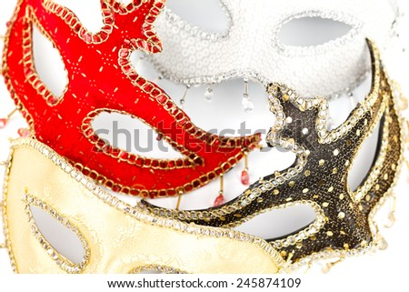 Closeup view of colorful carnival masks on white