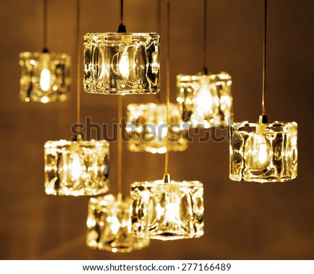 Closeup view of contemporary light fixture. Small bright lights creating a festive and romantic atmosphere. - stock photo