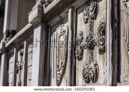 Closeup view of decorative cross - architectural detail on facade of the Basilica of Santa Maria Novella, Florence, Italy - stock photo