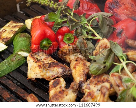 Closeup view of delicious barbecue meal with meat and vegetables. - stock photo