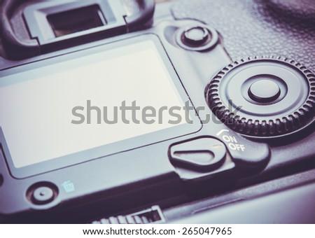 Closeup view of digital dslr camera - stock photo