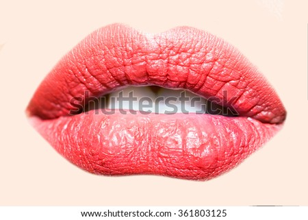 Closeup view of facial body part of beautiful sexual open female lips with sugar icing lipstick and white teeth, square picture - stock photo