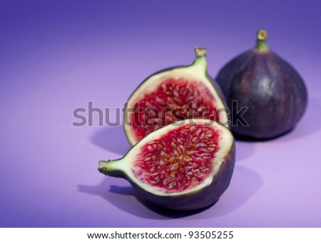 Closeup view of  fresh whole and halved figs - stock photo