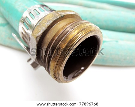 Closeup view of garden hose with shallow depth of field - stock photo